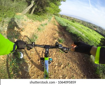 Pov of a mountain bike on a dirt path in Sardinia, Italy