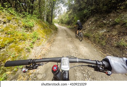 POV, Original point of view. Pair of man on mountain bike  in a mountainous road.