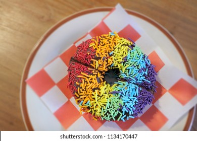POV (point of view) of Colourful Doughnut in LGBT rainbow flag, the gay pride flag or LGBT pride flag, is a symbol of lesbian, gay, bisexual and transgender pride and LGBT social movements.