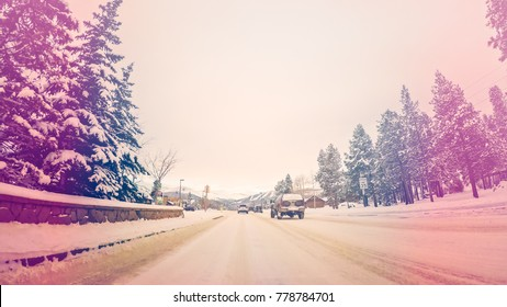 POV point of view - Driving in the mountains after winter storm in Colorado.