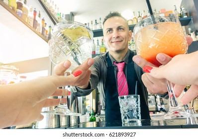 Pov prospective of young woman taking cocktails from professional bartender - Entertainment,party,lifestyle,drinking concept - Young people having fun for appetizer - Focus on barman hands glasses
