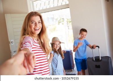 POV Shot Of Family With Luggage Leaving House For Vacation