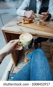 POV shot of woman holding coffee cup during date or meeting with friend or boyfriend, beautiful and inspiring beverage drink image, healthy hipster lifestyle