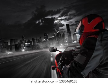 POV of super sport motorcycle driver riding towards big city. Outdoor photography. Travel and sport, speed and freedom concept