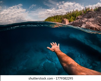 POV Swimming in crystal clear blue water split view