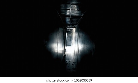 POV trying to escape from a dark room, going towards the light. Horror Halloween scary handheld shot.