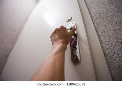 POV woman hand hold door handle of apartment from steep stairs
