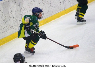 POVAZSKA BYSTRICA, SLOVAKIA - JANUARY 19,2019: Young hockey player of MSHKM Zilina Kristian Macak on the puck in league match against HK 95 Povazska Bystrica. MSHKM Zilina won this game 0-5.