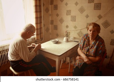 poverty old couple in the kitchen