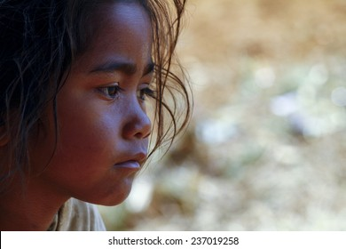 Poverty, portrait of a poor little African girl lost in deep thoughts