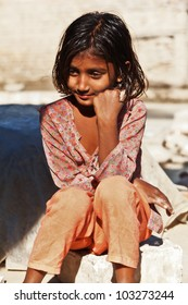 poverty, portrait of a poor little Indian girl lost in deep thoughts
