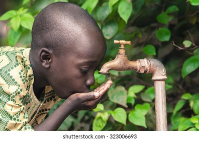 Poverty Symbol - Black Teen Drinking Water Tap Africa