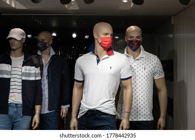 Povoa de Varzim, Portugal - July 17 2020: Mannequins in a clothing store window, wearing face masks during the Coronavirus / COVID-19 crisis.