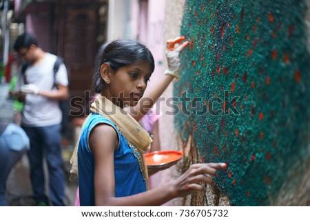india slum girl POWAI, MUMBAI, MAHARASHTRA, INDIA - OCTOBER 16, 2017 - Young slum girls