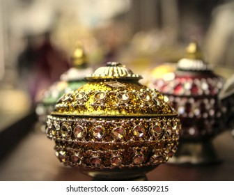 Its a powder box , Sindoor is red/orange powder used in indian tradition.Use of sindoor denotes that a woman is married in Hindu communities, and ceasing to wear it usually implies widowhood.