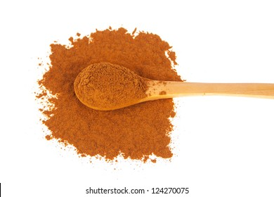 Powder cinnamon on spoon - white background
