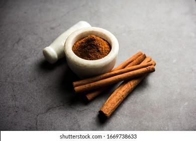 Powder cinnamon and sticks also known as Dalchini or Dalcheenee masala from India, selective focus
