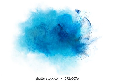 Powder explosion. Closeup of a blue dust particle explosion isolated on white. Abstract background
