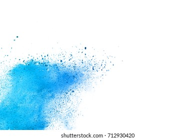 Powder explosion on white background. Colored blue cloud. Colorful dust explode. Paint Holi festival.