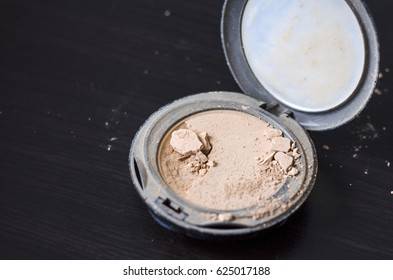 Powder puff makeup for women was broken by fall from high.