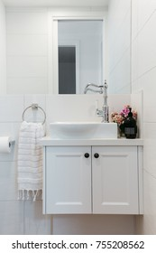 Powder room vanity in a contemporary country home