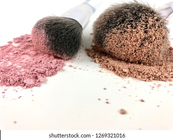 Powdered makeup and brushes on white background