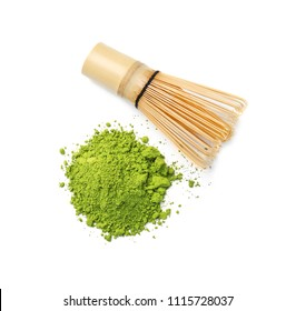 Powdered matcha tea and chasen on white background, top view