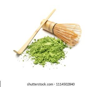 Powdered matcha tea, chashaku and chasen on white background