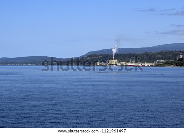 Powell River pulp mill and coastline seen from the ocean, British Columbia Canada