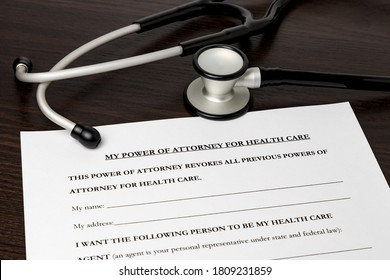 Power of Attorney for health care, HCPA, with stethoscope. Concept of planning for death, final wishes, terminal illness, and advance directive during Covid-19 coronavirus pandemic