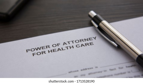 A power of attorney on the desk. Power of attorney for health care on the table.