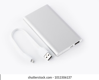 Power bank for charging mobile devices. White smart phone charger with power bank. battery bank. External battery for mobile devices.