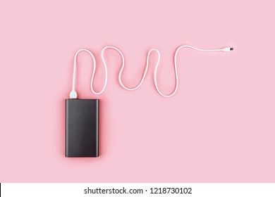 power bank gadget on a pastel background. portable battery for smartphone.