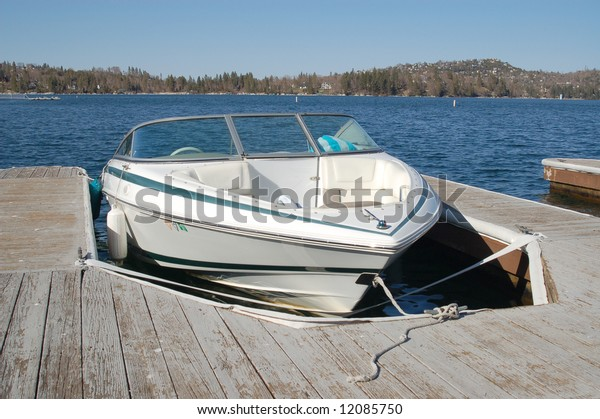 Power boat at a dock; Lake Arrowhead, California