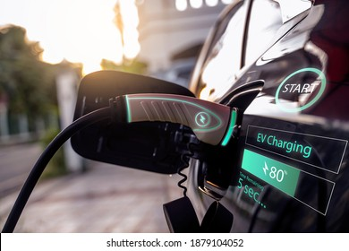 Power cable pump plug in charging power to electric vehicle EV car with modern technology UI control information display, car fueling station connected power cable alternative sustainable eco energy