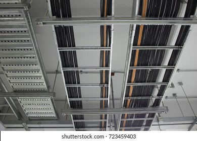 Power cables, Control cables and Instrument cables install on cable ladder and cable tray which fix support with concrete ceiling in electrical room