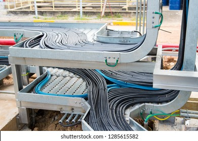 Power cables and instrument cables in the trays .Electric cables lying in metal cable trays.Cable tray and Cable ladder on Pipe Rack.