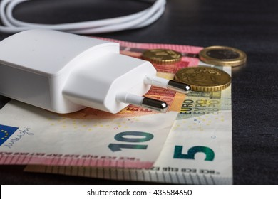 Power cord and euro banknotes. Expensive energy concept.
