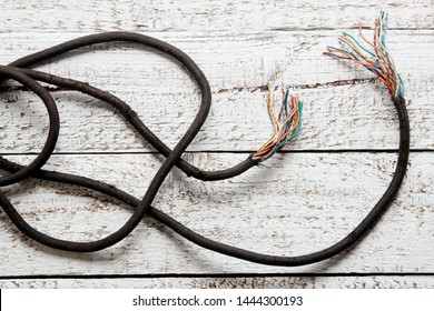 Power Cord on Rustic Wooden Background