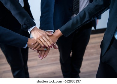 Power or corporate concept : Business man and woman bonding their hands together for showing their unity.