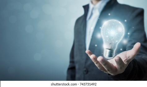 The power of creativity, technology, innovation or new business to success in the future concept, Businessman holding light bulb