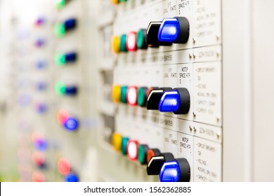 Power distributing cabinet,Electrical selector switch,button switch,Electrical switch gear at Low Voltage motor control center cabinet in power plant. blurred for background.