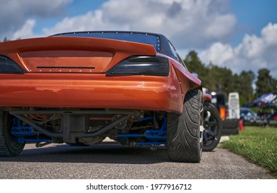 Power drifting car from side. back view