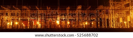 power electric transformers during the night panorama view electricity distribution