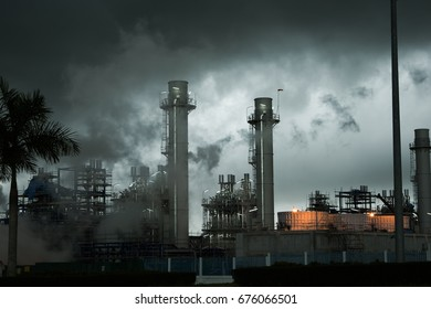 power electricity plant with pipes and smoke in rain cloud. rayong thailand.