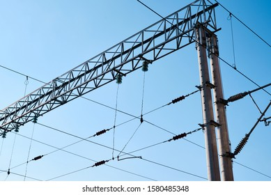 Power electricity wire for trains against blue sky. Close up of railway electrification system