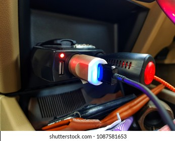 Power external USB port with cigarette lighter in car.