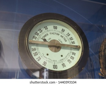 power factor meter to measure the power factor of a transmission system, defined as cosine of the angle between the voltage and current