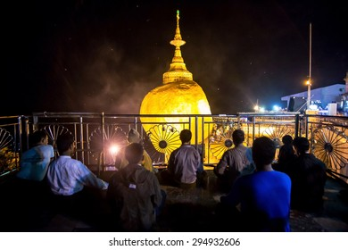 Power of faith , everyday at night and very low light myanmar people concentration and pray to make them lucky , Golden Rock , Kyaiktiyo Kyaikhtiyo Myanmar