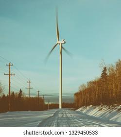 Power generating wind turbine in Winter. Stylized faded look.